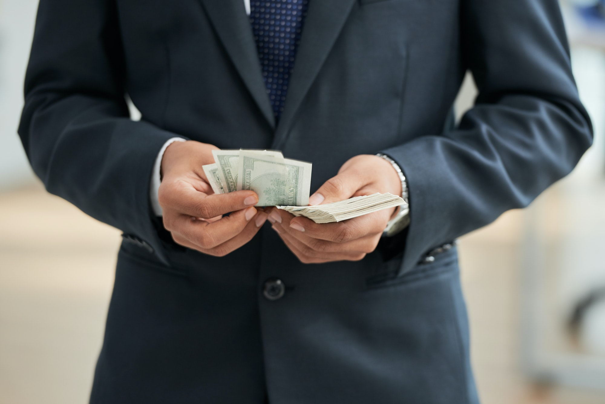 Businessman with dollar currencies