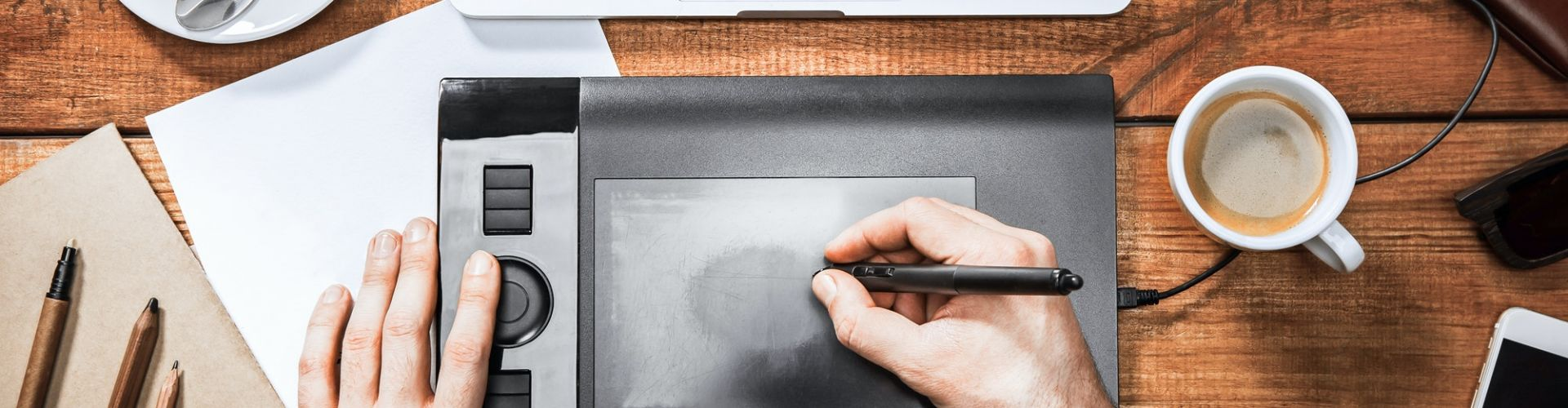 Graphic Designer working with interactive pen display, digital Drawing tablet and computer